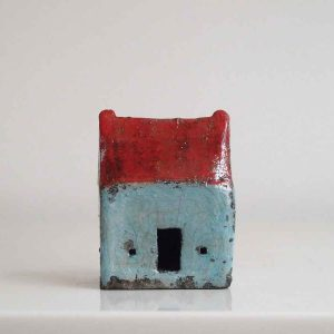 Small red roof blue house